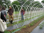 Shannon Jones and Bryan Dyck of Broadfork Farm, leading a farm tour to apprentices and aspiring famers in June 2011.