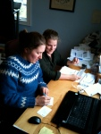 Farming involves plenty of office-work too! Patricia teaches farm-hand Justine, at Taproot Farms, NS
